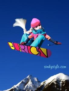 Sindy snowboards wearing Burton